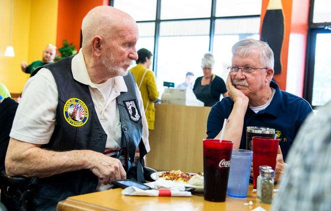 Ron Baldwin and Chuck Welch talk while they enjoy breakfast with other veterans at the Village Inn on Tuesday, May 25, 2021. (Rich Janzaruk / Herald-Times)
