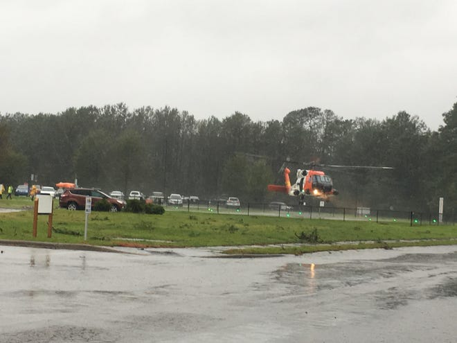 A Coast Guard helicopter lands at Onslow Memorial Hospital during Hurricane Florence.