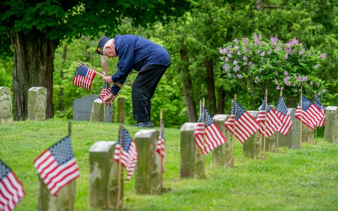Bruce Stewart, 86, of Peoria, a veteran of both the U.S. Army and Air Force, flags grave Friday, May 22, 2020 on Soldiers Hill in Springdale Cemetery. A group of volunteers from American Legion Post 2, Team RWB and others gathered to prepare the gravesites for Memorial Day visitors and a ceremony Sunday.