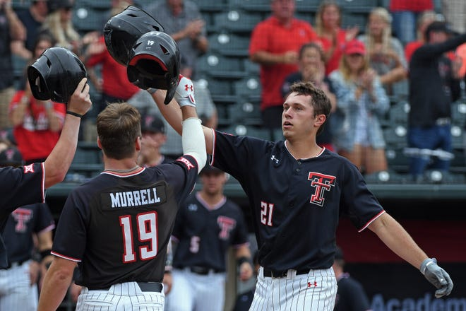 Texas Tech's Nate Rombach (21) celebrates with teammate Easton Murrell (19) during a Big 12 Tournament game Wednesday at Chickasaw Bricktown Ballpark in Oklahoma City.