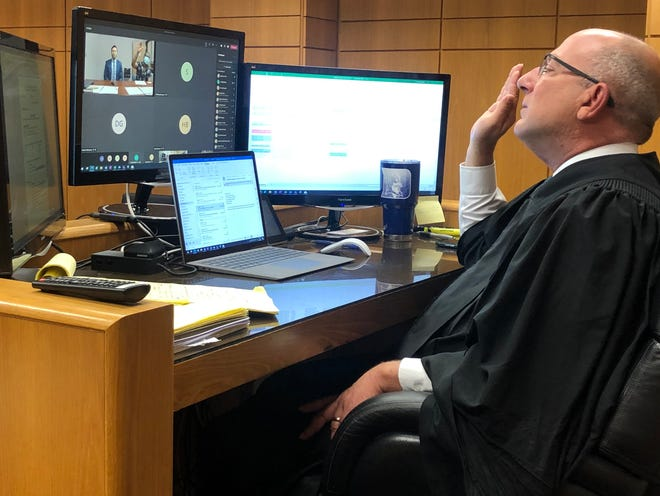 10th Judicial Circuit Court Judge Kevin Abdoney swears in a person on trial during a virtual hearing at the Polk County Courthouse on Thursday, May 27.  (Photo by Dustin Wyatt)