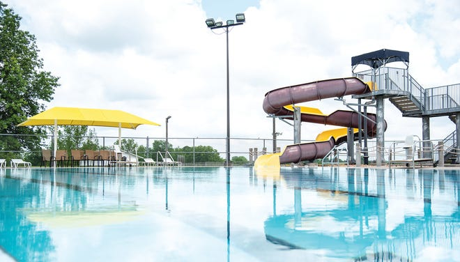 The Eldon Aquatic Center readies its slide and pool area for the opening date of May 29.
