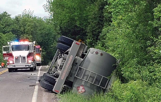 A truck rests on its side following a crash Tuesday at Tonganoxie Drive and 199th Street. The crash resulted in a diesel spill.