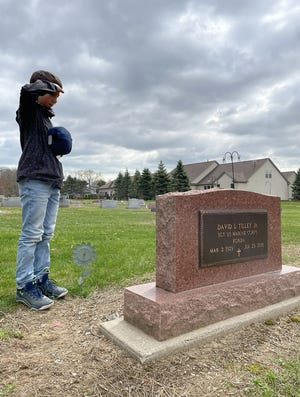 Jameson Ziesmaer, 11, salutes the grave of his great-grandfather, Sgt. David L. Tilley Jr., who died in 2015 at age 86 after serving in the Marines Corps his entire life. Jameson and his brother often visit the cemetery in South Rockwood to pay their respects.