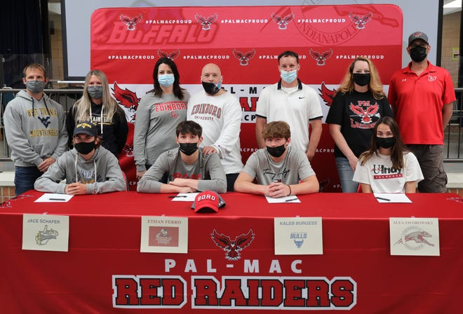 From the left, Jace Shafer, Ethan Ferro, Kaleb Burgess and Alea Javorowsky celebrate their National Letters of Intent.