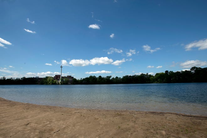 A 16-year-old Framingham teen drowned in Learned Pond on Wednesday evening, after jumping from a rope swing and not resurfacing, May 27, 2021. This is a view of the pond from the beach area.
