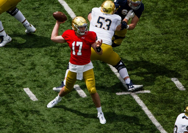 Notre Dame quarterback Jack Coan, seen throwing a pass during the 2021 Blue-Gold Game, will face his former team when the Irish play against Wisconsin on Sept. 25, 2021.