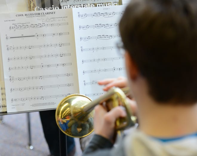 The COVID-19 pandemic brought many challenges to area music education programs. Band and chorus directors had to find creative ways to keep their students making music harmoniously despite remote learning, the smaller class sizes of hybrid learning and social distancing during in-person learning. In this pre-pandemic O-D file photo, a student reads his music during band class.