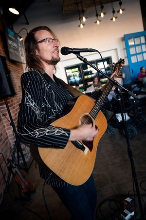 Kyle Dillingham performs at Frenzy Brewing Co. during the Edmond VIBES event in May. Numerous visual and performing artists will once again be part of the upcoming June VIBES event planned in downtown Edmond.