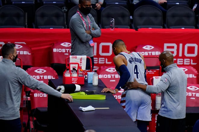 Washington guard Russell Westbrook (4) is helped to the dressing room after suffering an ankle injury during Wednesday night's NBA playoff game against Philadelphia.