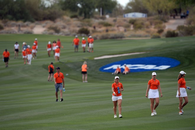 May 26, 2021; Scottsdale, Arizona, USA; Oklahoma State University golfers walk the course after being defeated by Ole Miss during the NCAA Women's Golf Championship Final at Grayhawk Golf Club. Mandatory Credit: Joe Camporeale-USA TODAY Sports