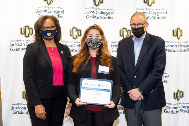 Pictured, left to right, are Jeanetta Sims, dean of the University of Central Oklahoma's Jackson College of Graduate Studies; Leila Murphy, first-place winner of the recent Three Minute Thesis competition; and Edmond businessman Bob Weiss, sponsor of the event.
