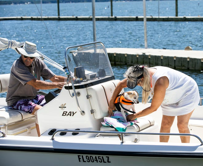 In this file photo from April 22, 2020, boater William Mann backs his craft into Lake Weir as his wife, Mary Wagner-Mann, and their dog Jesie James prepare to leave the Carney Island Recreation & Conservation Area at Lake Weir. The Florida Department of Health in Marion County has rescinded a health alert issued on May 17 advising against recreation due to a blue-green algae bloom.