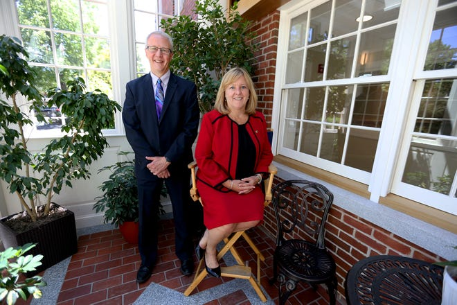 From left, Rick Wallis is stepping down and Joan Gile is stepping up as the president and CEO at Piscataqua Savings Bank in Portsmouth.