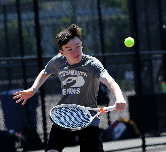 Portsmouth's Ryan Porter returns a shot in his No. 1 singles match against Coe-Brown in Thursday's Division II boys tennis preliminary round match at South Mill Playground.
