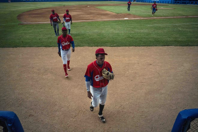The Cuban baseball team, walking off the field after a training session in Havana last week, lost one of its players Wednesday when infielder Cesar Prieto defected soon after the team arrived in Miami.