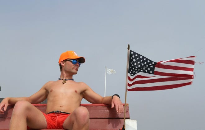 Lifeguard Andrew LaVallee, 25, of South Kingstown, watches swimmers at Scarborough State Beach South, Narragansett, in 2017.