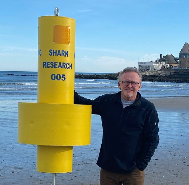 Jon Dodd, executive director of the Atlantic Shark Institute in Wakefield, stands with one of the institute's acoustic receivers, which are used to detect sharks in Rhode Island waters.