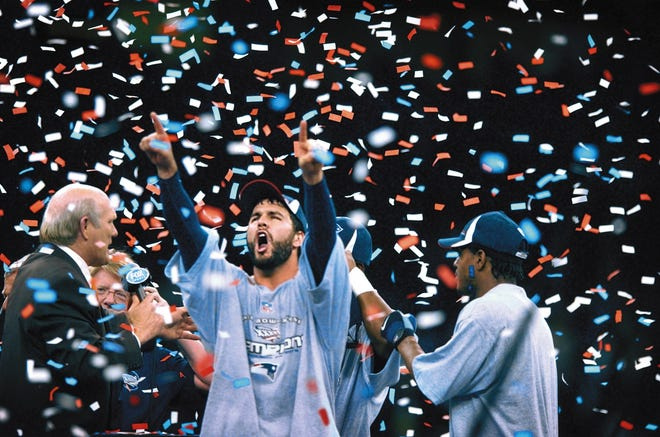 Adam Vinatieri celebrates the Patriots beating the St. Louis Rams in Super Bowl XXXVI in 2002. On Wednesday, the former Pats and Colts kicker announced his retirement.