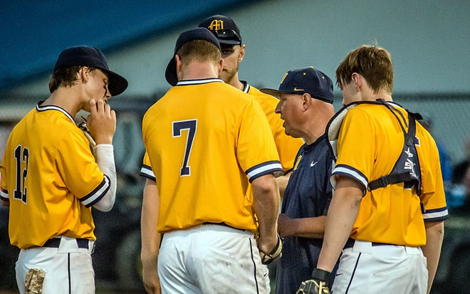 Pioneer head coach Eric McGaha talks with his pitcher, senior Tommy O'Connor, during the sectional game against Franklin on Wednesday, May 26, 2021. (Eric Scott Miller / Correspondent)