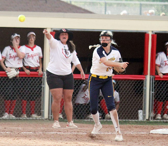 Mooresville junior Kendall Grover throws to first base for a double play after snagging a line drive in Wedesday's IHSAA Class 4A Sectional against Center Grove. (Melissa Dillon/Correspondent)