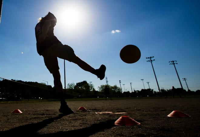 Kevin Kulesia kicks a ball during a recent Best Damn Sport and Social Club game at Rose Park in Mishawaka.