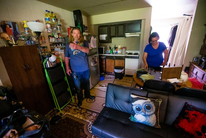 Carl Broockerd, left, and Thann Mack talk about conserving energy from their generator since their apartment building has no power Thursday, May 27, 2021 at Kamm's Island Apartments in Mishawaka.
