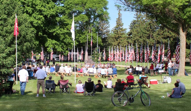 Thisfamiliarscene in Home Cemetery will be replayed this year on Memorial Day, weather permitting. In case of inclement weather the program will be in the St. Mary's School Gym at 9:30 a.m.