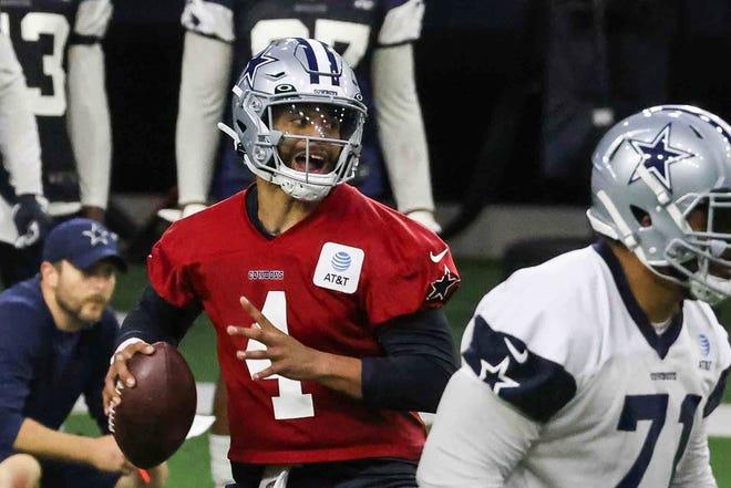 Quarterback Dak Prescott, 4, drops back to throw during the Cowboys' full-squad offseason workouts in Frisco, Texas on Tuesday.