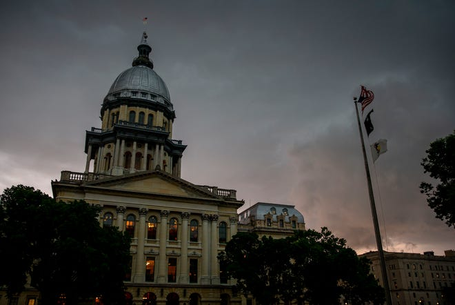 A line of a severe thunderstorms moves in over the Illinois State Capitol in Springfield, Ill., Thursday, May 27, 2021.