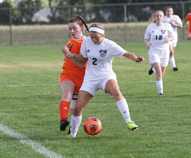 Laci Gottschalk of Sturgis keeps a ball in play against Vicksburg in district action on Wednesday.