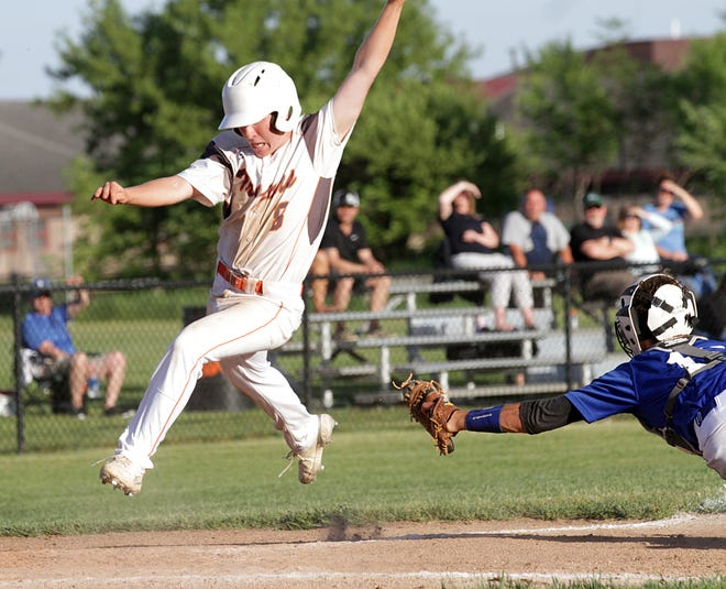 Luke Herman avoids the tag from the Plainwell catcher at home plate to score a run for Sturgis in the second game on Wednesday.