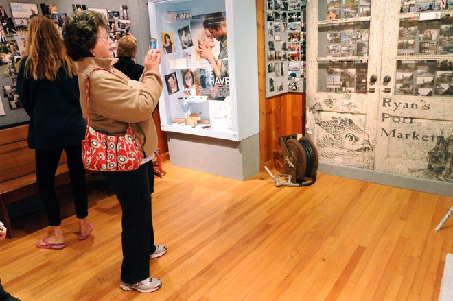 """Donna Harding of New Hampshire takes photos of the """"Safe Haven"""" display at the Southport Museum and Visitors center in March 2013."""