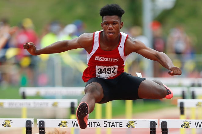 Shawnee Heights' Jeremiah Smith beats the competition in Thursday's 110 meter hurdles for the Class 5A state championship at Cessna Stadium at Wichita State Unviersity.