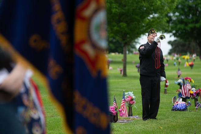 """Jay Stevenson plays """"Taps"""" on his bugle during last year's virtual Memorial Day ceremony at Memorial Park Cemetery."""