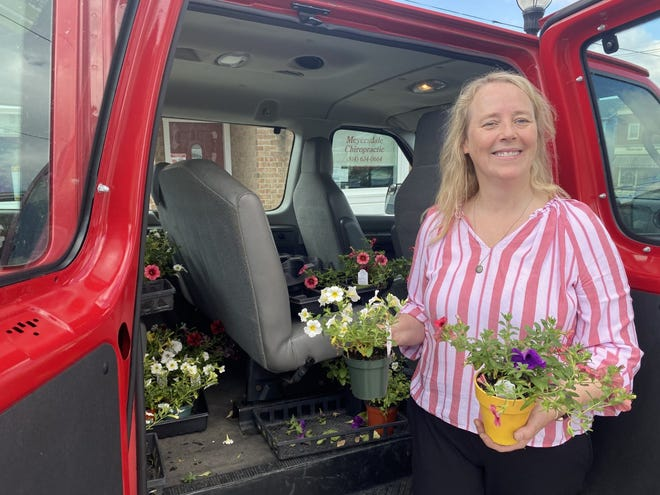 Julie Stahl delivering flowers that Meyersdale Area FFA grew for this season.