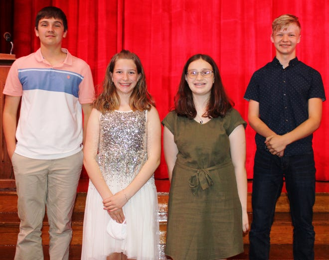 """Four Meyersdale Middle School eighth grade students were selected to participate in the annual Memorial Day observance in Meyersdale.  From left, Ryan Sechler and Jaylynn Anderson  received the American Legion Auxiliary 8th Grade Award, sponsored by Post 112. Emilee Stewart and James Kretchman were presented with the American Legion Auxiliary Award. Sechler recited the Gettysburg Address and Anderson """"In Flanders Field"""" during the ceremony."""