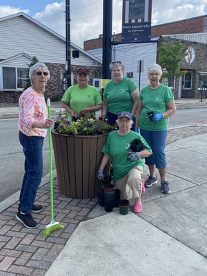 Meyersdale Area FFA with president Abby Shuck helped the flower box planting with teacher Doreen Jameson for Maple City Garden Club. Trailing petunias was the selection to beautify the light post planters. Garden club members are from left: Mary Ann Strong, Connie Anderson, Helen Miller, Jane Shultz, and kneeling Ethel Stevanus. In separate photo is Julie Stahl. Glenda Shultz also helped plant the flowers.