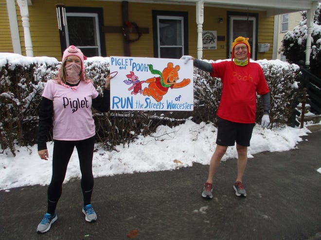Karen Pajer, left, and Scott Schaeffer-Duffy are in full attire just before a winter run during their quest.
