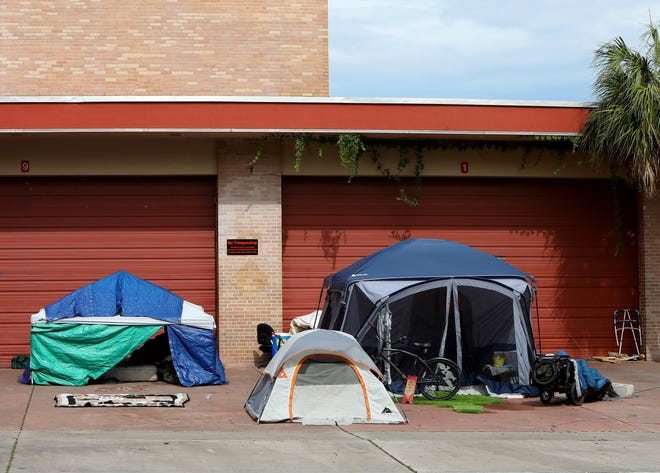 A homeless camp in the driveway of the old Fire Station No. 1 on Main Street in Gainesville.