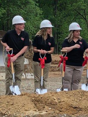 Superintendent Mark Murphy, Tessa Lambert and Stacey Bettis take part in the groundbreaking ceremony.