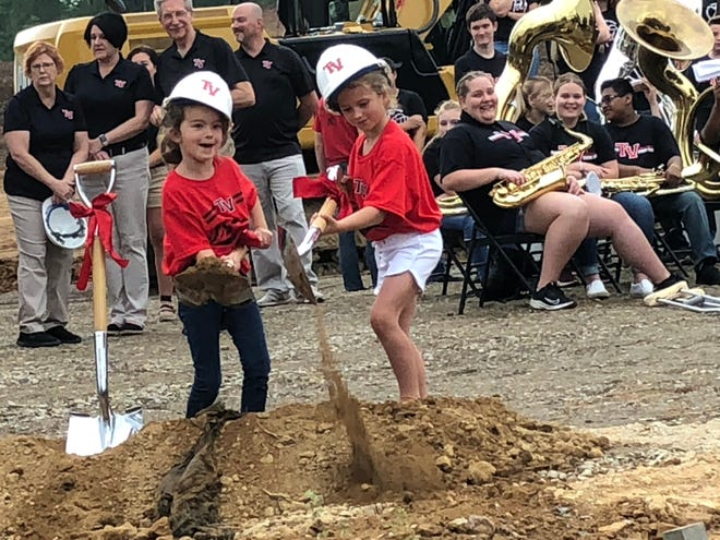 Students Ruby Chumney and Ava Albaugh take part in the groundbreaking at Tusky Valley.