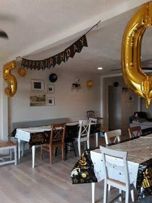 Birthday decorations for the celebration Lovina's children planned.