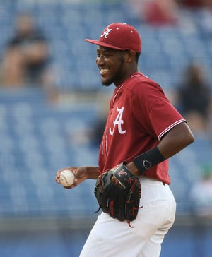 Alabama pitcher Dylan Smith (25) smiles after snagging a ball hit up the middle by a Florida batter during the SEC Tournament Thursday, May 27, 2021, in the Hoover Met in Hoover, Alabama. [Staff Photo/Gary Cosby Jr.]