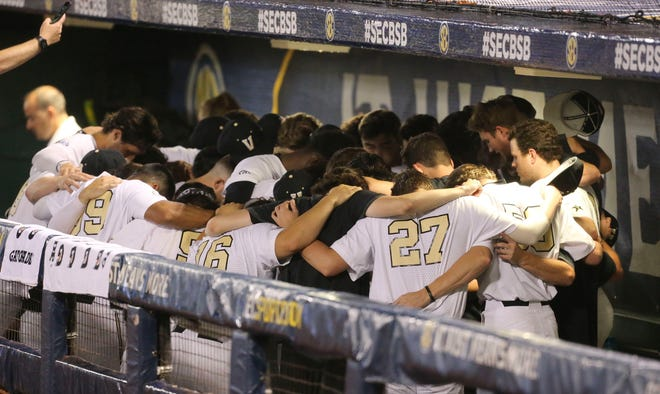 Vanderbilt players huddle together in the dugout before playing Ole Miss during the SEC Tournament Tuesday, May 26, 2021, in the Hoover Met in Hoover, Alabama. [Staff Photo/Gary Cosby Jr.]