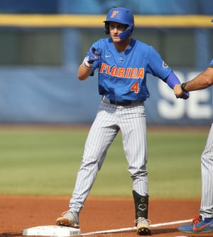 Florida hitter Jud Fabian (4) arrives at first with a single as he plays against Alabama during the SEC Tournament Thursday, May 27, 2021, in the Hoover Met in Hoover, Alabama. [Staff Photo/Gary Cosby Jr.]