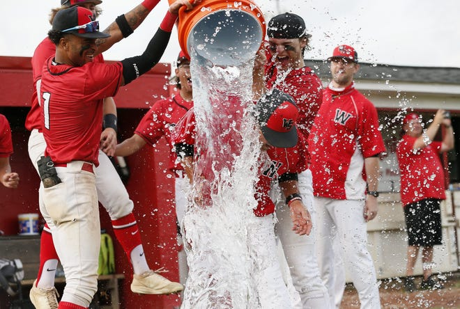 South baseball coach Tim Bates gets a bucket of water dumped on his head following the Wildcats' 3-2 win over visiting Hilliard Darby in a Division I district final May 26. South captured its first district title after being therunner-up in 1960, 1961 and 1992.