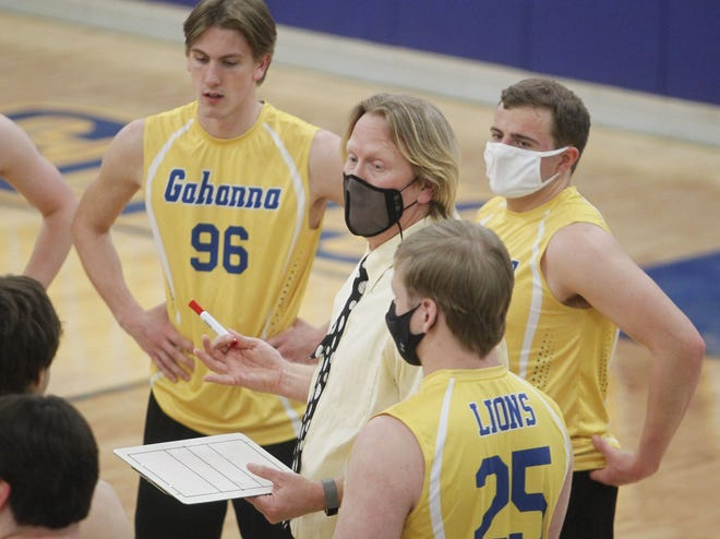 Gahanna boys volleyball coach Mike Sage talks to his team during a home match against Reynoldsburg on April 1. Sage has stepped down after 17 seasons as coach.