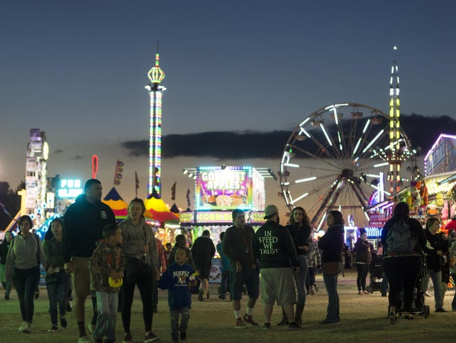 SBC Fair attendees mingle in the event's carnival section during the 2018 event in Victorville.