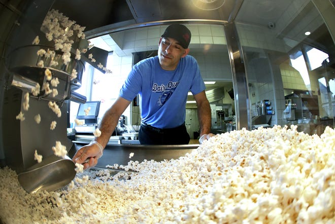 Sean Vindhurst, owner of the DQ Grill & Chill at 910 Gay Drive in Neenah, makes batches of Archie's Famous Popcorn. The tasty snack is named after his late grandfather, Archie Reiser.